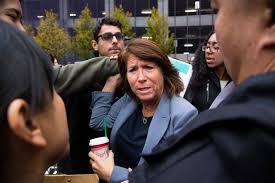 uc regents increase tuition uc regents bonnie reiss yells back at the protesters as police make a path through