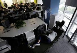 kou meng product manager of renren credit management co in beijing sleeps on camp bed office