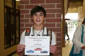 colton miertschin poses with his certificate for a new 20000 car porter dealership