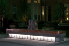 individual chairs are surrounded by a plinth of glass block with lighting from beneath bench lighting