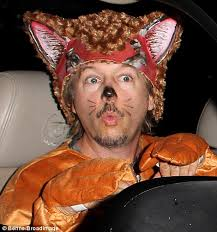 Comedian David Spade was dressed as a foxy feline creature as he roared into the party - article-2478022-1907204F00000578-49_470x502