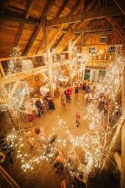 barn wedding lighting twinkle light trees secured to the barns beams wedding barn wedding lighting