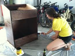 lauren applying a layer of polyurethane finish to the vinyl record shelf front shot finished vinyl record