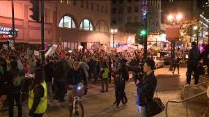 hundreds of anti trump protesters rally in the streets of downtown all