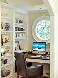 tucked into a tight alcove thats used for a home office this round window makes a powerful architectural statement in a relatively alcove office