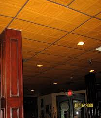 sagging tin ceiling tiles bathroom: recommended is painting t grid to match tiles