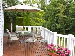 Outdoor Deck Design Ideas wood deck with white railing posts and umbrella