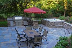 patio outdoor stone kitchen bar: the natural stone patio set in a random regular pattern the natural stone veneer hot tub walls and the natural stone outdoor kitchen are all complemented