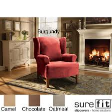 appealing chair design using surefit stretch suede wing chair slipcover in burgundy plus fireplace and rug burgundy furniture decorating ideas