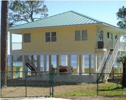 images about beach houses pilings on Pinterest   House on       images about beach houses pilings on Pinterest   House on stilts  House plans and Beach houses