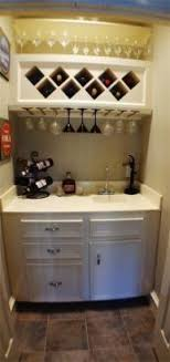 this little wet bar is tucked away in a hidden closet just off the living black mini bar home wrought