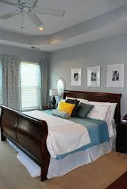 very similar to our master bedroom layout complete with tray ceiling and fan love the oval mirrors above nightstands the bedding drapes and photo color bedroom colors brown furniture