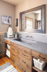 bathroom vanity uk company countertop combination: in the owners bathroom the reclaimed oak used else where in the house is stained for a darker more refined look the countertop is concrete