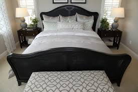 small bedroom with black wicker bed frame featuring a clamshell design bedroom with black furniture