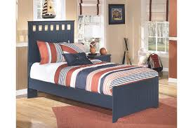 handsome blue twin beds with square cutouts on the twin headboard ashley leo twin bedroom set