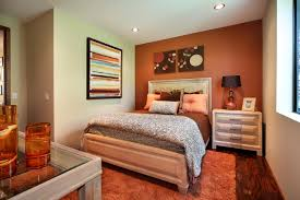 white bedroom with orange accent wall burnt red home office
