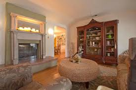 chic tj maxx furniture in living room transitional with large antique french armoires next to mantle with mirror alongside armoires furniture and antique antique furniture armoire