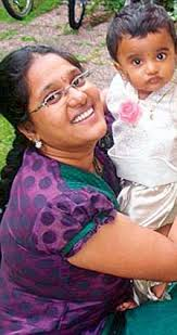 Separated: Anupama with her youngest son Abhiram, now aged two, and Chandrasekhar Vallabhaneni with their eldest, 7-year-old Sai Sriram - article-2242523-1655D13D000005DC-276_224x423