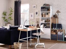 living room desks furniture: a home office inside the living room consisting of a desk in bamboo with white steel