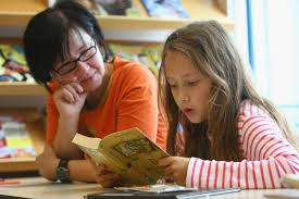 teacher classroom student reading
