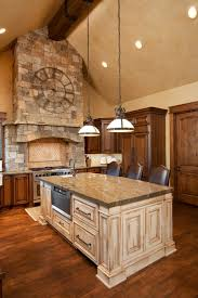 build kitchen island sink: rich natural wood kitchen holds this large contrasting light wood island at center