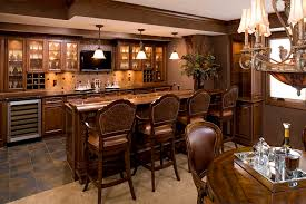 glass breakfast bar top kitchen traditional with wall mount tv glass front cabinets bar top lighting