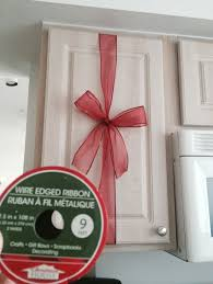 cheap christmas decor: dollar tree ribbon cheap and simple but nice christmas decor