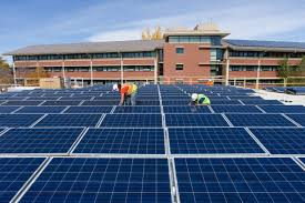 on college campuses signs of progress on renewable energy yale e contractors install solar panels atop colorado state university s braiden hall