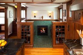 handsomely detailed with cabinets and tile the fireplace inglenook lends period style to the addition arts crafts home office