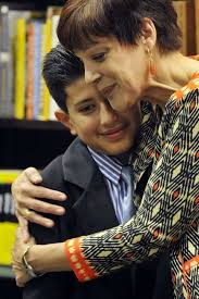 stamford student    s essay wins award for teacher   stamfordadvocatemiriam gonzerelli hugs her student  luis guaillas  after he  his winning essay  quot