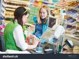 customer buying food supermarket making check stock photo customer buying food at supermarket and making check out cashdesk worker in store