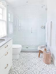white bathroom floor: bathroom floor tile not so plain white bathroom with great walk in shower grey amp white floor tiles and grey countertop add interest to basic white room
