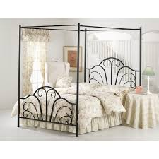 black glazed wrought iron canopy bed with curved footboard and headboard using soft flower pattern bedding black wrought iron furniture
