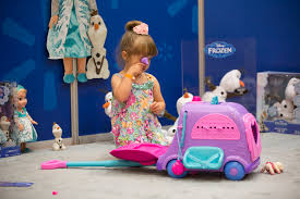 a little girl gets to preview great holiday toys in the chosen by kids event jpg credit monitoring