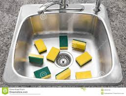clean kitchen: lots of yellow sponges in a clean kitchen sink