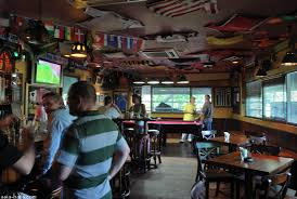 the upstairs sports bar is reached by either stairs or a lift at the rear of the cafe here the decor also emphasises dark timbers for the furniture and bar bar furniture sports bar