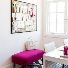 hot pink bench with black framed cork board black and white office design