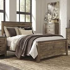 leons furniture bedroom sets http wwwleonsca: vintage casual styling o warm rustic plank finish o over replicated oak grain o authentic touch the trinell bedroom features a warm rustic plank finish over