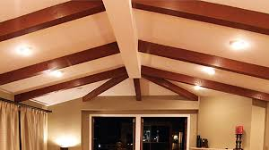 cathedral ceiling with up lighting between exposed beams in open plan living area cathedral ceiling lighting ideas