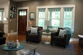 appealing small space living room furniture ideas with green colored sofa and dark brown bench on appealing small space living