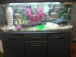 4 ft fishtank with grey cabinet and lighting unit 180 litres miscellaneous goods 1 cabinet and lighting