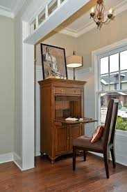 computer armoire desk living room traditional with abattant bead board beige walls chandelier crown moulding dark armoire office