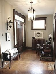 lantern light fixtures entry eclectic with baseboard desk entry bench foyer front door lantern leather cushion beach house lighting fixtures