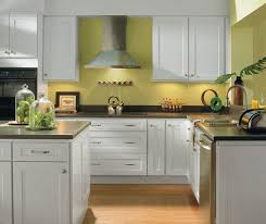 in style kitchen cabinets:  alpine white shaker style kitchen cabinets by homecrest cabinetry