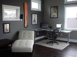 interior delightful home office design with cornered l shaped desk plus cool black computer chair combine with white rug on the dark wood floor combine amazing modern home office interior