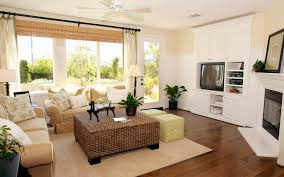 living room ravishing home living room design showing large glass windows behind beige fabric sofa using track arm plus rattan coffee table has a black carpets bedrooms ravishing home