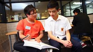 Sydney University Compass volunteers lend homework help at Whitlam     Compass volunteer Richie Lim with high school student Nicholas Thai at Whitlam Library     s Homework Centre