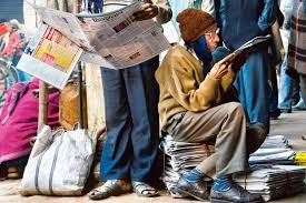 photo essay  newspaper nation  slideshow  livemint at chandni chowk in old delhi two men are engrossed in their copies of the newspaper photographs sanjay austa