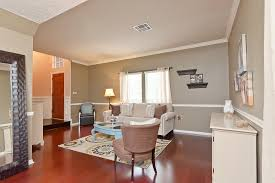 steps away lies the formal living and dining room with custom neutral paint hardwood floors allowing natural light fill