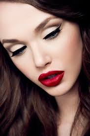 winged eyeliner and a bold red lip